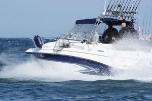 Professional Deep Sea Fishing Boat Speeding Through the Ocean